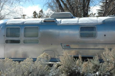 snow melting on an Airstream
